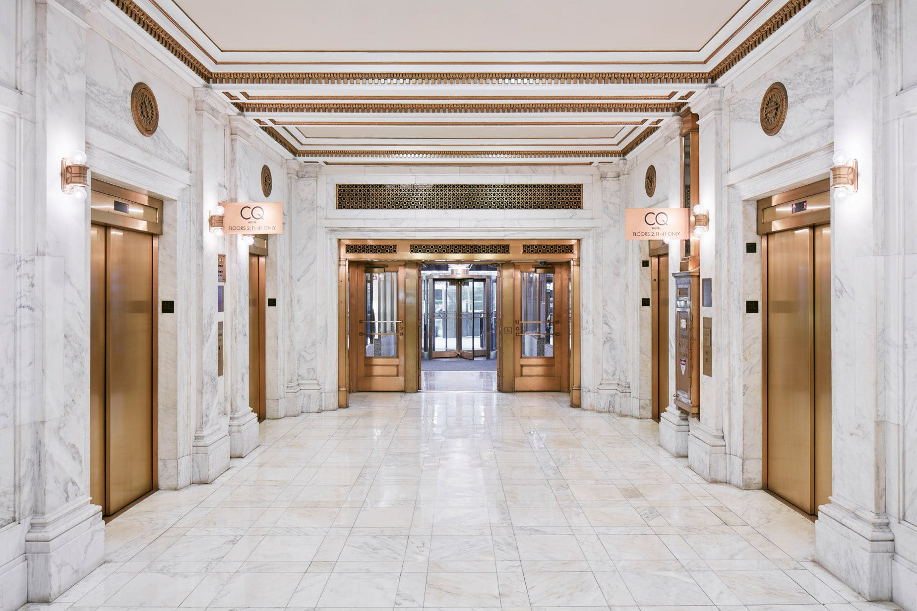 Marble lobby leading to the elevators at Club Quarters Hotel, Wacker at Michigan, Chicago