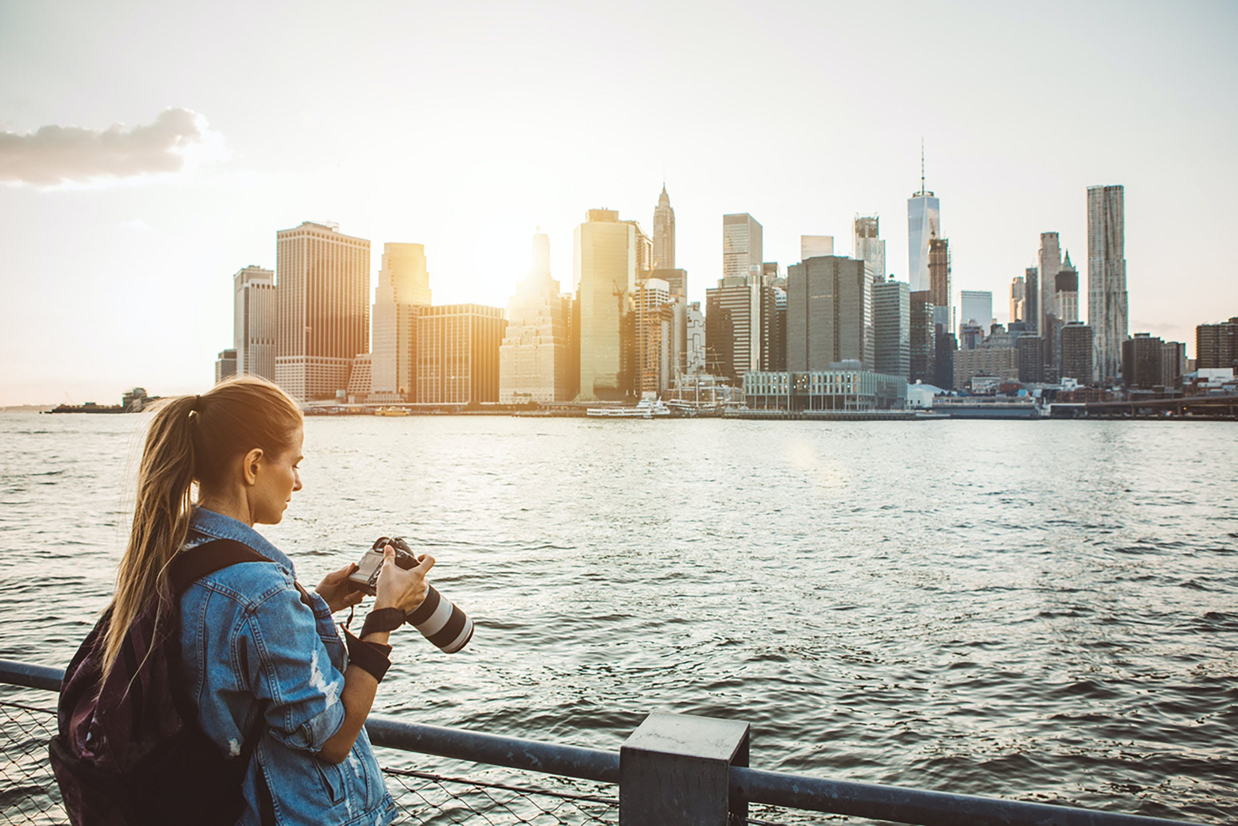 Woman taking a picture of Lower Manhattan - New York City