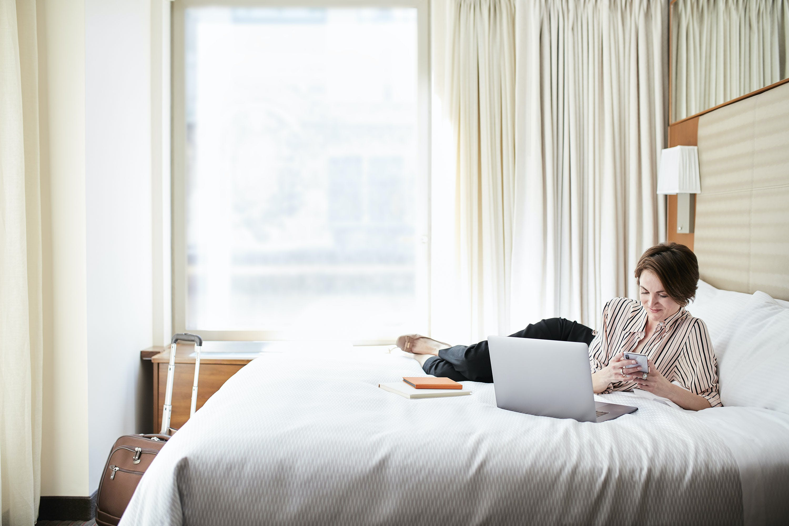 Comfy beds, for sleeping or working, at Club Quarters Hotel, Grand Central