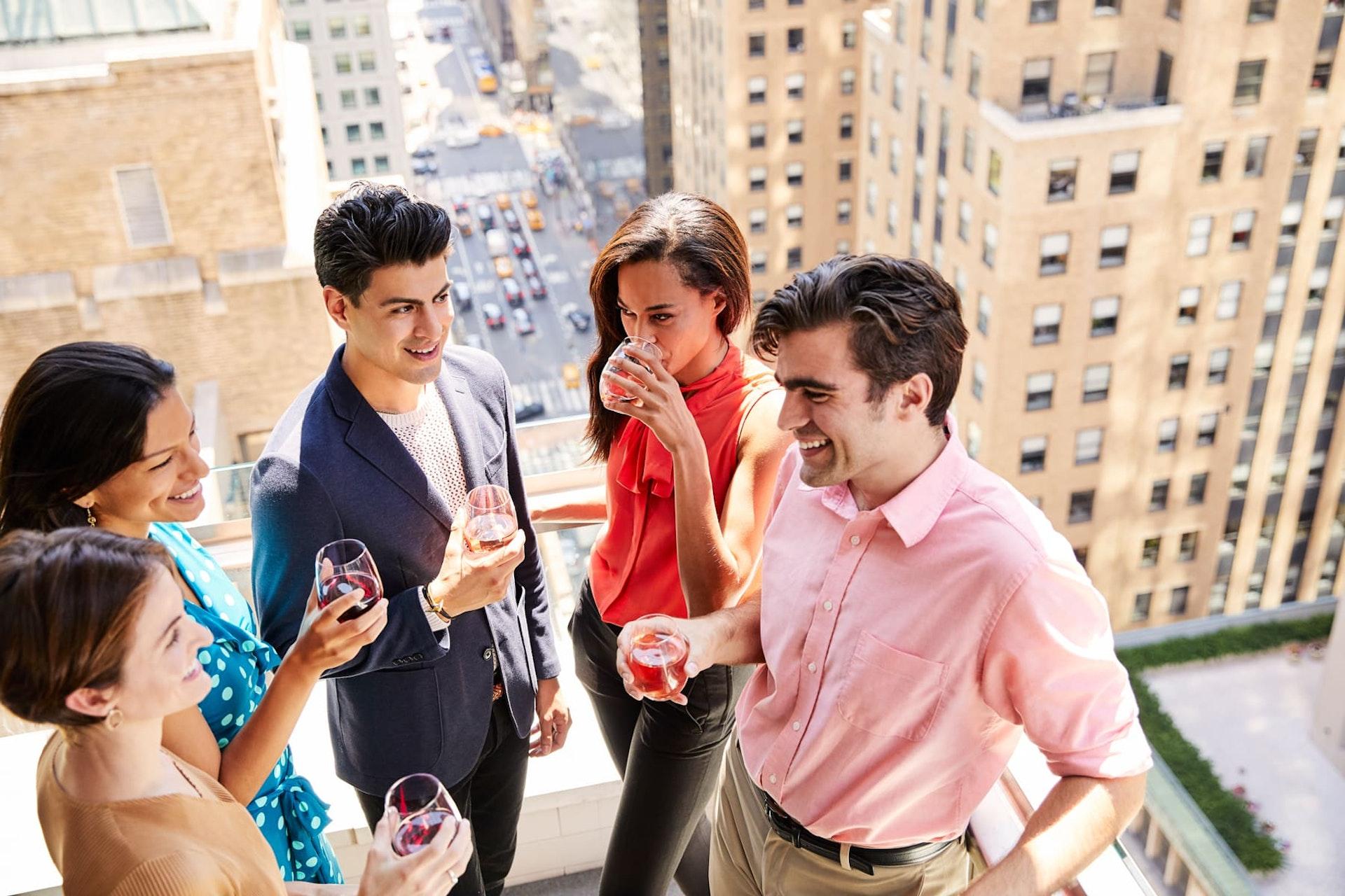 Friends drinking wine on terrace