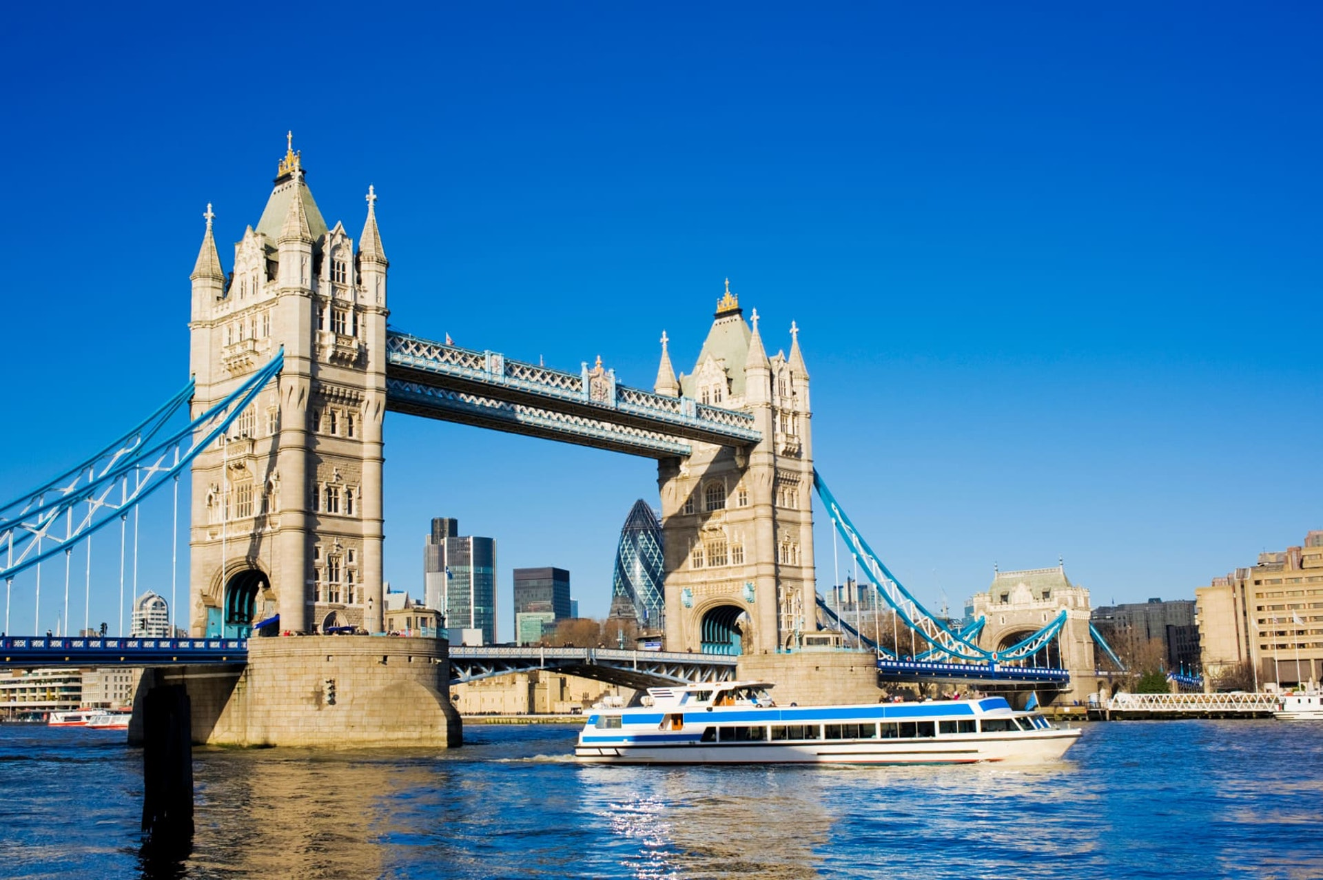 Tower Bridge with boat on River Thames