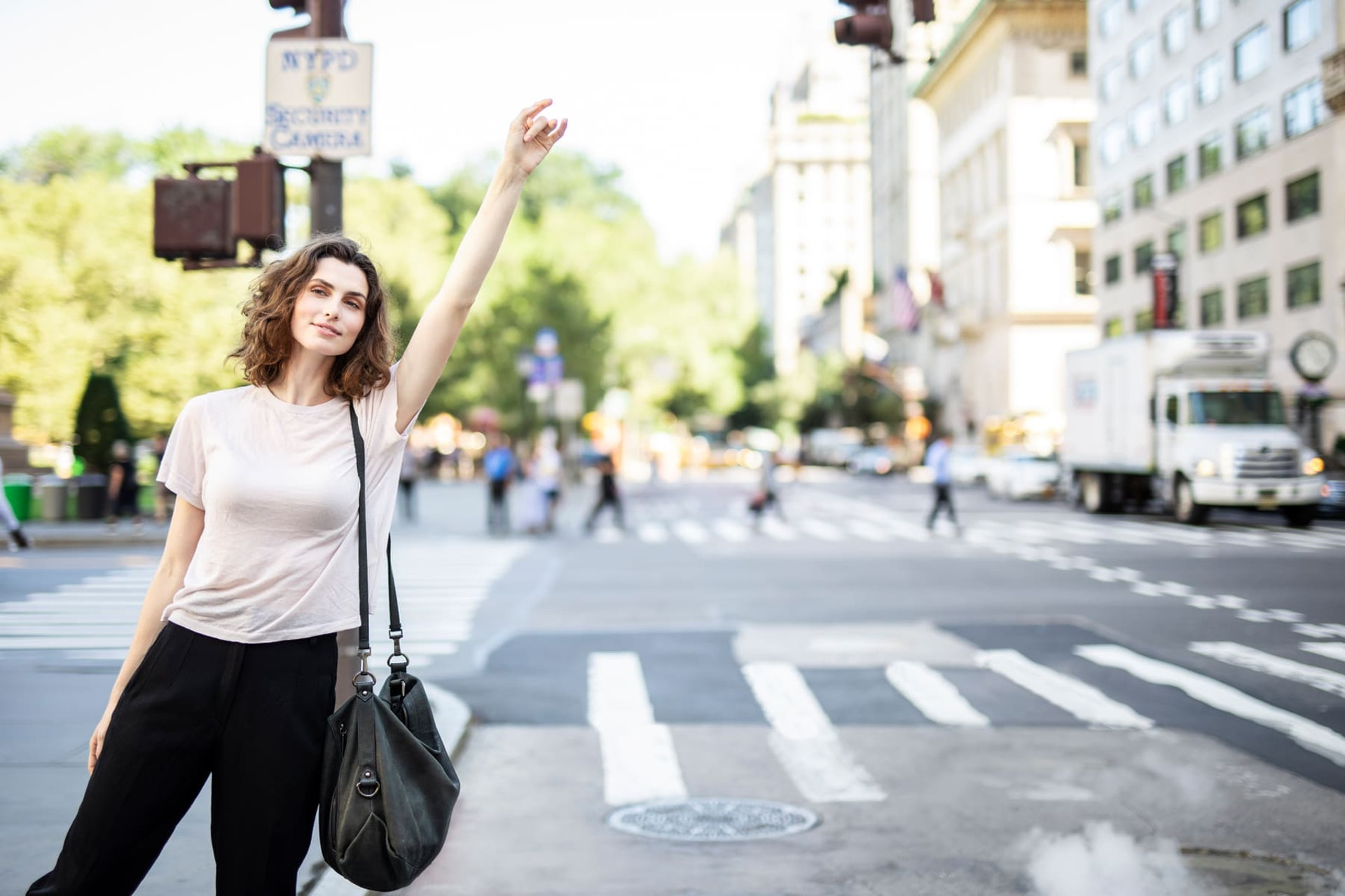 Woman hailing a cab in New York