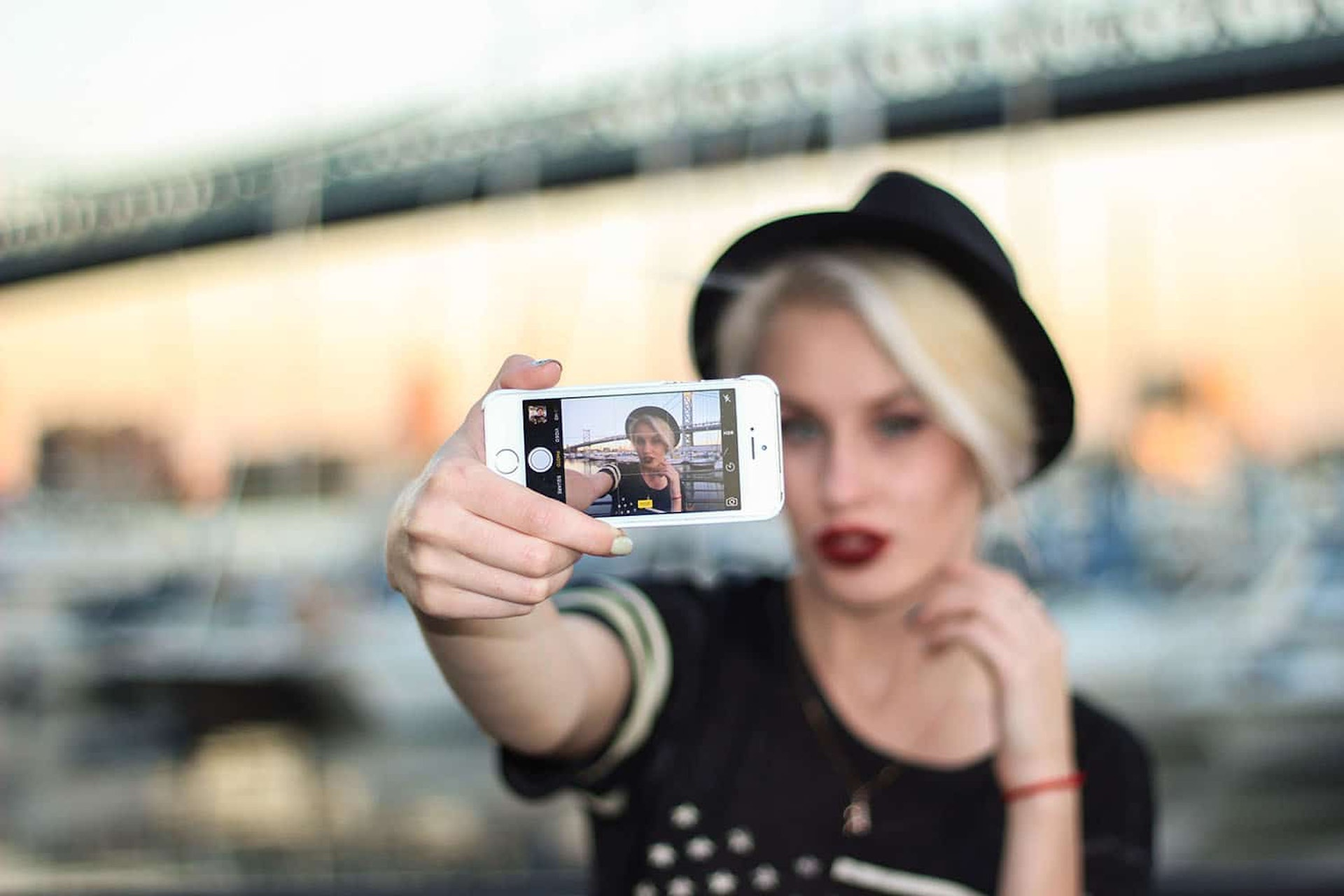 Woman taking a selfie on a smartphone